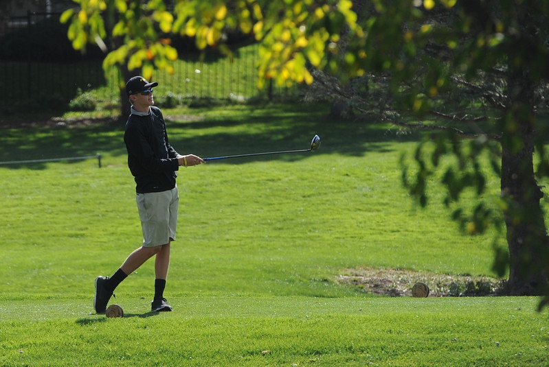 Thompson Valley's Darren Edwards watches his tee shot on the 15th hole during the second and final round of the 4A Boys State Golf Championship on Tuesday at Raccoon Creek in Littleon.