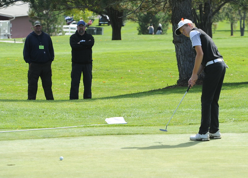 Berthoud's Cameron Poll watches his putt on the 18th green Mountain View's Wes Weber surveys the seventh green during the second and final round of the 4A Boys State Golf Championship on Tuesday at Raccoon Creek in Littleton.