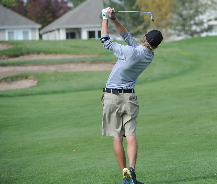 Thompson Valley's Nate Dwyer watches his approach on the 15th hole during the second and final round of the 4A Boys State Golf Championship on Tuesday at Raccoon Creek in Littleton.