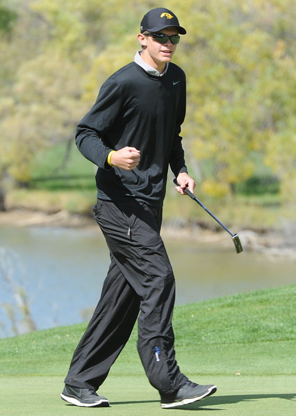 Thompson Valley's Darren Edwards pumps his fist after making a birdie on the ninth hole during the second and final round of the 4A Boys State Golf Championship on Tuesday at Raccoon Creek in Littleton.