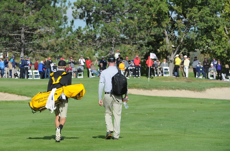 Thompson Valley senior Darren Edwards walks up the 18th fairway with his coach Derek Shagin during the second and final round of the 4A Boys State Championship on Tuesday at Raccoon Creek in Littleton.