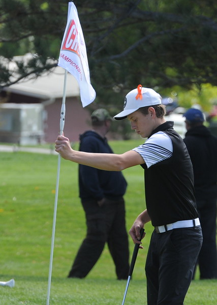 Berthoud's Cameron Poll finishes up the 18th hole Mountain View's Wes Weber surveys the seventh green during the second and final round of the 4A Boys State Golf Championship on Tuesday at Raccoon Creek in Littleton.