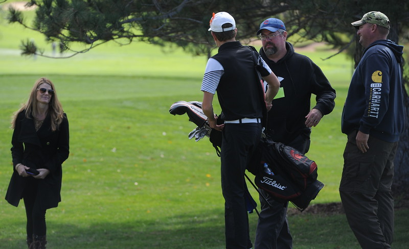 Berthoud's Cameron Poll shakes hands with his coach, Mike Burkett, after finishing up his round Mountain View's Wes Weber surveys the seventh green during the second and final round of the 4A Boys State Golf Championship on Tuesday at Raccoon Creek in Littleton.