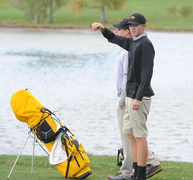 Thompson Valley's Darren Edwards tosses some grass in the air to judge the wind on the 17th tee during the 4A State Golf Championship on Tuesday at Raccoon Creek in Littleton.