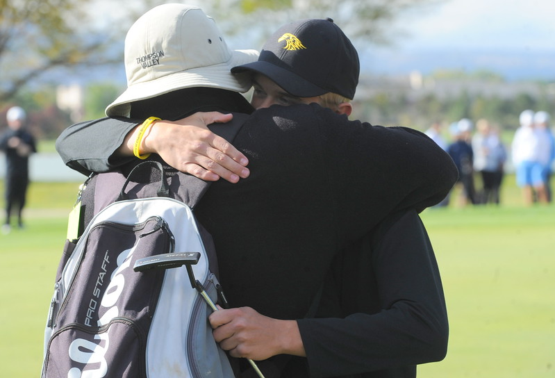 Thompson Valley's Darren Edwards hugs his dad after winning the 4A Boys State Golf Championship on Tuesday at Raccoon Creek in Littleton.