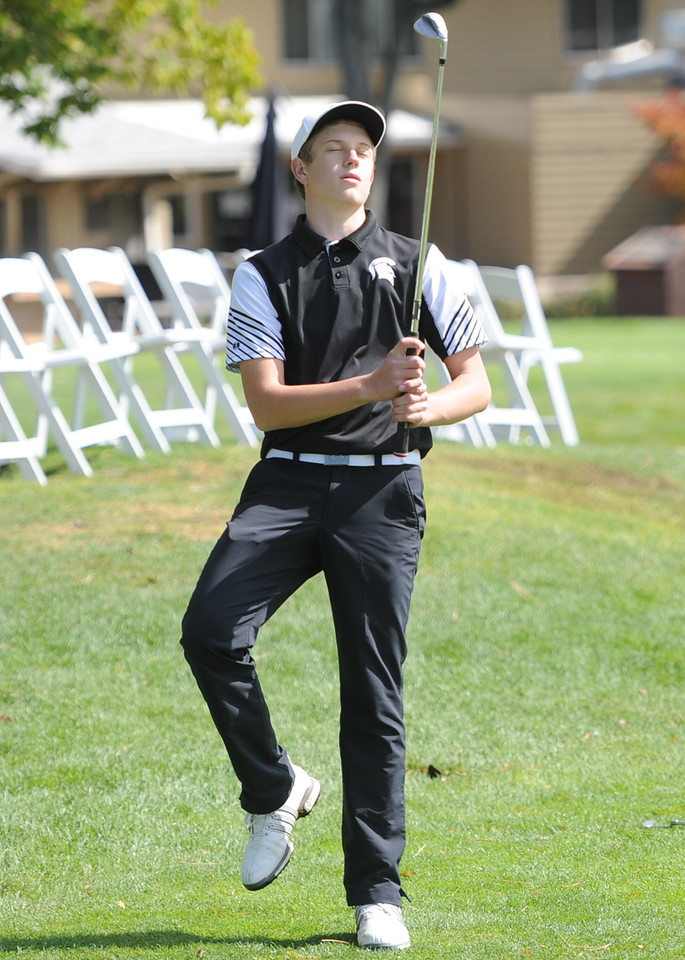 Berthoud's Cameron Poll reacts to his chip shot on the 18th hole Mountain View's Wes Weber surveys the seventh green during the second and final round of the 4A Boys State Golf Championship on Tuesday at Raccoon Creek in Littleton.