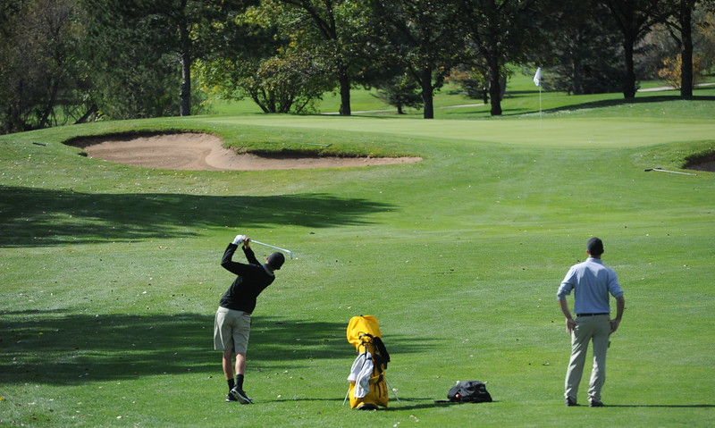 Thompson Valley's Darren Edwards watches his approach shot on the 14th hole during the second and final round of the 4A Boys State Golf Championship on Tuesday at Raccoon Creek in Littleton.
