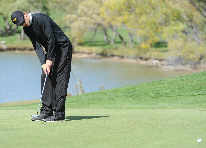 Thompson Valley's Darren Edwards watches his birdie putt makes its way to the cup on the ninth hole Mountain View's Wes Weber surveys the seventh green during the second and final round of the 4A Boys State Golf Championship on Tuesday at Raccoon Creek in Littleton.