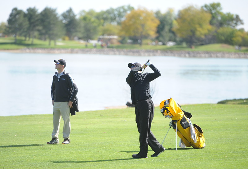 Thompson Valley's Darren Edwards watches his approach shot on the seventh hole Mountain View's Wes Weber surveys the seventh green during the second and final round of the 4A Boys State Golf Championship on Tuesday at Raccoon Creek in Littleton.