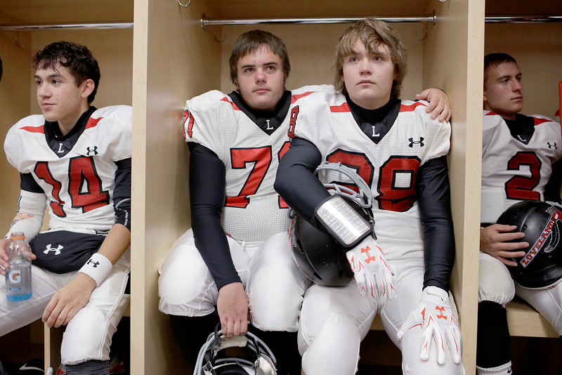 Blanco Julian (14), Jason Vanhook (71), Caden Nye (28) and Brenen Butts (2), Loveland football players, wait in the locker room at Invesco Field for the 4A state championship game to start on Saturday, Dec. 5, 2015 in Denver. (Photo by Trevor L. Davis/Loveland Reporter-Herald)