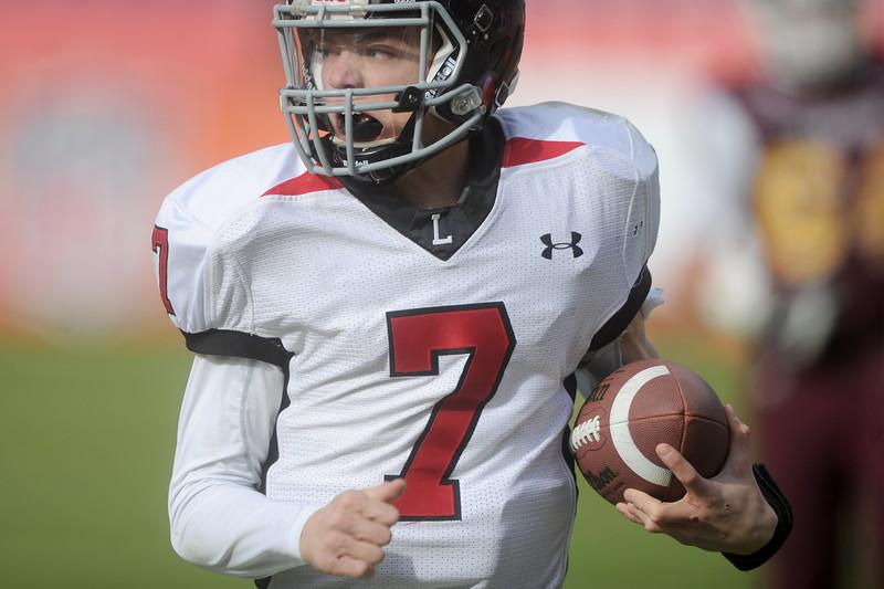 Ayden Eberhardt (7), Loveland High quarterback, runs for a first down in during the second quarter against Windsor on Saturday, Dec. 5, 2015 in Denvner. (Photo by Trevor L. Davis/Loveland Reporter-Herald)