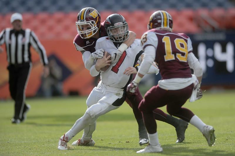 Ayden Eberhardt (7), Loveland quarterback, sacked by Zach Moser (14), Windsor defenseman, on Saturday, Dec. 5, 2015 in Denver.(Photo by Trevor L. Davis/Loveland Reporter-Herald)