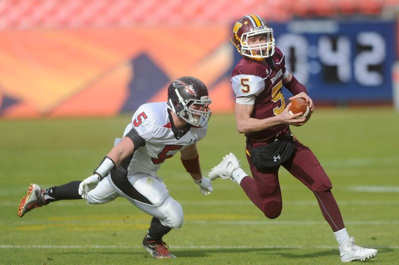 Charles Dunkelman (5), Loveland High linebacker, chases down Brad Peeples (5), Windsor quarterback, on Saturday, Dec. 5, 2015 in Denver. (Photo by Trevor L. Davis/Loveland Reporter-Herald)