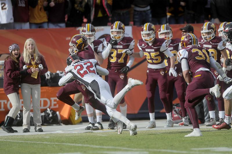 Kaden Morin (22), Loveland safety,  tackles Landon Schmidt (16), Windsor wide receiver on Saturday, Dec. 5, 205 in Denver. (Photo by Trevor L. Davis/Loveland Reporter-Herald)