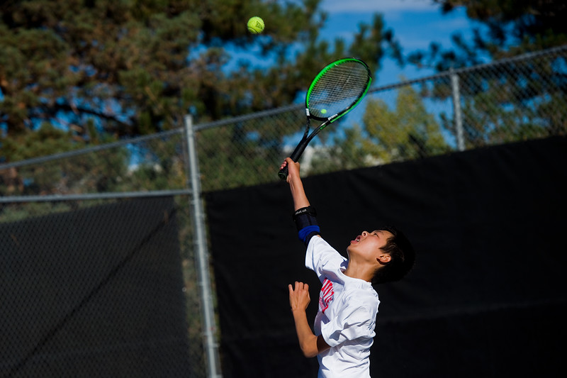 "Fairview's Andy Wu serves the ball while playing a doubles match with Beck Chrisbens against Cherry Creek, during the 5A boys tennis tournament at the Gates Tennis Center in Denver on Saturday. <br /> More photos:  <a href=""http://www.BoCoPreps.com"">http://www.BoCoPreps.com</a><br /> (Autumn Parry/Staff Photographer)<br /> October 15, 2016"