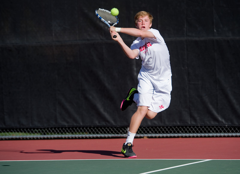 """Hall Humphrey makes a return while playing a doubles match with Aaron Nguyen against Denver East, during the 5A boys tennis tournament at the Gates Tennis Center in Denver on Saturday. <br /> More photos:  <a href=""""http://www.BoCoPreps.com"""">http://www.BoCoPreps.com</a><br /> (Autumn Parry/Staff Photographer)<br /> October 15, 2016"""