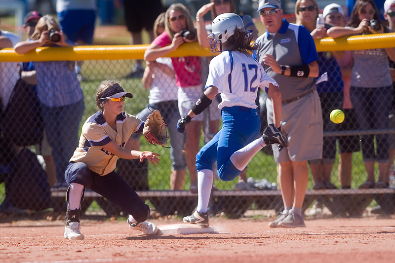 "Broomfield's Kendall Lockwood makes it safely to first base during the 5A region 1 softball tournament at Broomfield High School on Saturday.<br /> More photos:  <a href=""http://www.BoCoPreps.com"">http://www.BoCoPreps.com</a><br /> (Autumn Parry/Staff Photographer)<br /> October 15, 2016"