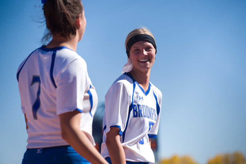 "Broomfield's Linnie Malkin (left) celebrates with a fellow teammate after winning the game against Legacy during the 5A region 1 softball tournament at Broomfield High School on Saturday.<br /> More photos:  <a href=""http://www.BoCoPreps.com"">http://www.BoCoPreps.com</a><br /> (Autumn Parry/Staff Photographer)<br /> October 15, 2016"