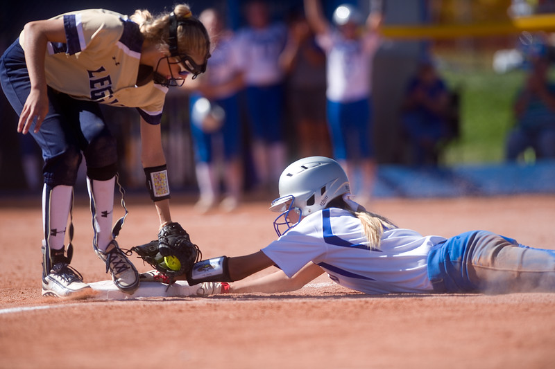 "Legacy's Sam Conradie tries to tag out Broomfield's MacKenzie Jackson during the 5A region 1 softball tournament at Broomfield High School on Saturday.<br /> More photos:  <a href=""http://www.BoCoPreps.com"">http://www.BoCoPreps.com</a><br /> (Autumn Parry/Staff Photographer)<br /> October 15, 2016"