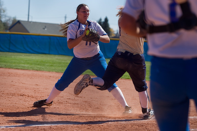 "Broomfield's Matti Morales tags out a legacy player on first base during the 5A region 1 softball tournament at Broomfield High School on Saturday.<br /> More photos:  <a href=""http://www.BoCoPreps.com"">http://www.BoCoPreps.com</a><br /> (Autumn Parry/Staff Photographer)<br /> October 15, 2016"