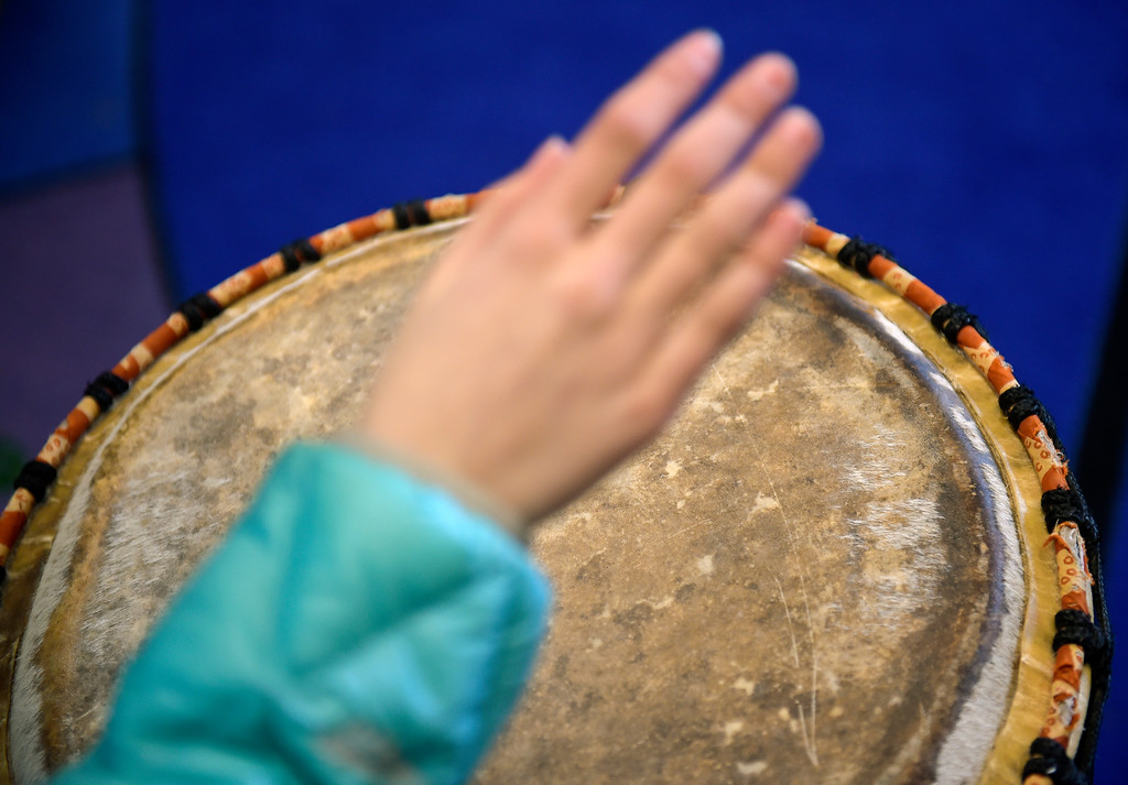 """. LAFAYETTE CO - MARCH 11: An African drum is played during rehearsal at Ryan Elementary March 11, 2019. Ryan Elementary is putting on \""""A Walk Through Time\"""" event on the slave trade this week. To view more photos visit dailycamera.com. (Photo by Lewis Geyer/Staff Photographer)"""