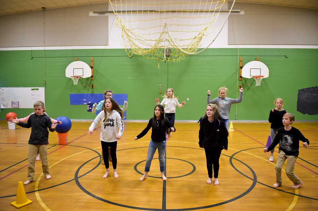 """. LAFAYETTE CO - MARCH 11: Fifth graders rehearse a dance routine at Ryan Elementary March 11, 2019. Ryan Elementary is putting on \""""A Walk Through Time\"""" event on the slave trade this week. To view more photos visit dailycamera.com. (Photo by Lewis Geyer/Staff Photographer)"""