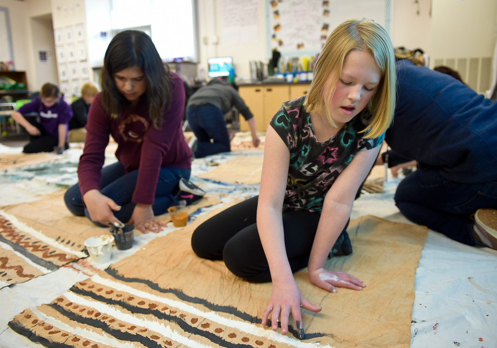 """. LAFAYETTE CO - MARCH 11: Fifth graders Johanna Mailly, left, and Nikki Niekamp paint backdrops at Ryan Elementary March 11, 2019. Ryan Elementary is putting on \""""A Walk Through Time\"""" event on the slave trade this week. To view more photos visit dailycamera.com. (Photo by Lewis Geyer/Staff Photographer)"""