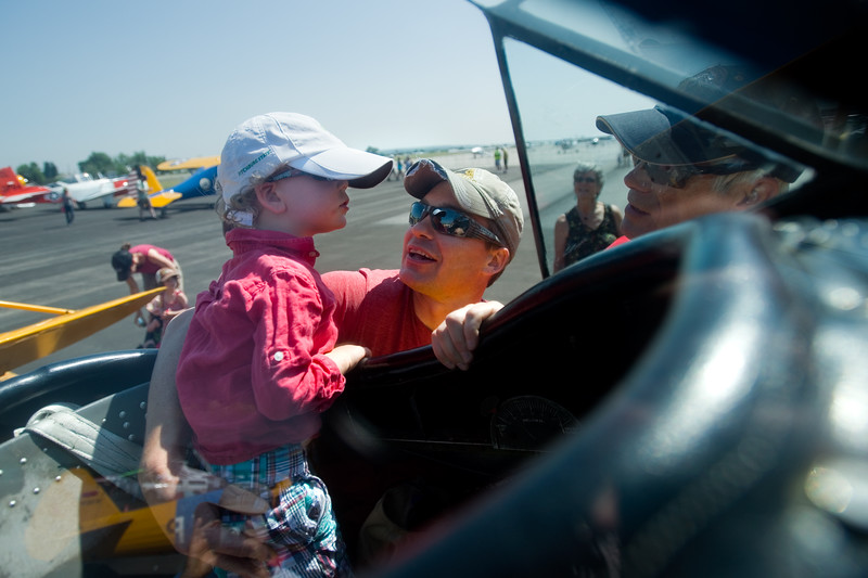 "Jacob Durling and his son Holden Durling, 3, check out a N3N-3 naval trainer, that was used during WWII, on display at Airport Day at the Boulder Municipal Airport on Saturday. <br /> More photos:  <a href=""http://www.dailycamera.com"">http://www.dailycamera.com</a><br /> (Autumn Parry/Staff Photographer)<br /> June 18, 2016"