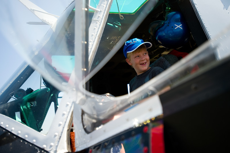 "Mason Elings, 9, sits in a 1970 Bell UH-1H Huey firefighting helicopter during Airport Day at the Boulder Municipal Airport on Saturday. <br /> More photos:  <a href=""http://www.dailycamera.com"">http://www.dailycamera.com</a><br /> (Autumn Parry/Staff Photographer)<br /> June 18, 2016"