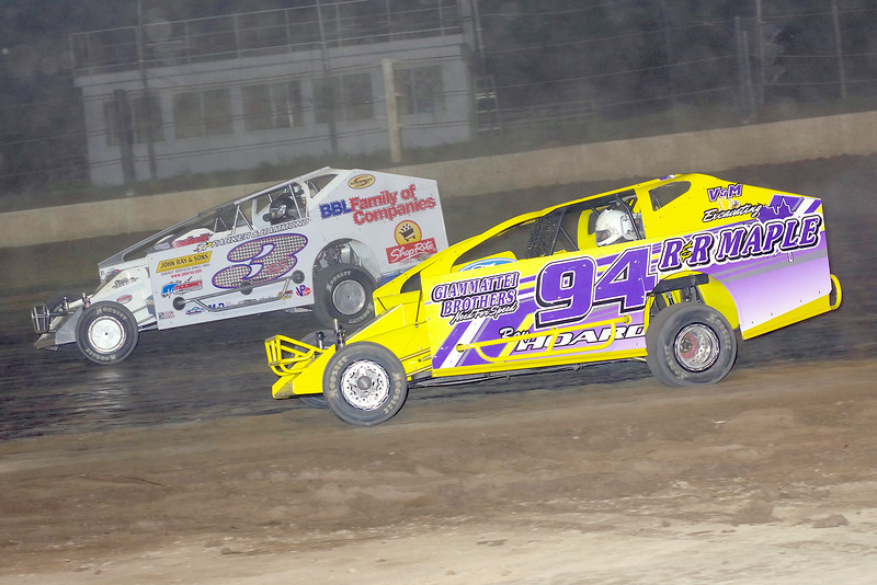 """Mod action Ray Hoard #94 & Brian Gleason #3G at Albany-Saratoga Speedway, Friday, July 6. Photos courtesy Kustom Keepsakes - Mark Brown and Ryan Karabin. For reprints and more visit <a href=""""https://nepart.smugmug.com"""">https://nepart.smugmug.com</a>"""
