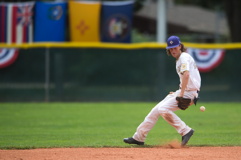 """Boulder's Cooper Moore catches a ball in the infield during the game against Albuquerque's Post 13 during the American Legion Western Regional Tournament at Scott Carpenter Park in Boulder on Friday.<br /> More photos:  <a href=""""http://www.BoCoPreps.com"""">http://www.BoCoPreps.com</a><br /> (Autumn Parry/Staff Photographer)<br /> August 5, 2016"""