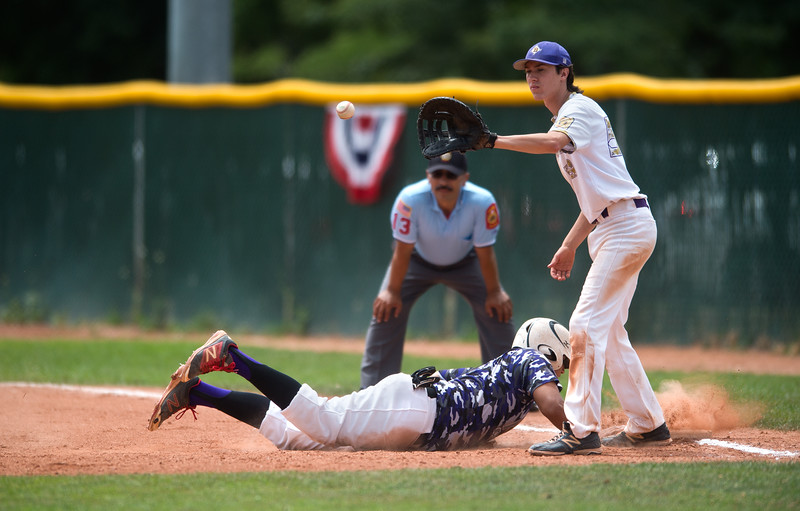 "Boulder's Brendan VanHaute catches an attempted pickoff throw as Albuquerque's Martin Gallegos slides safely back onto first base during the American Legion Western Regional Tournament at Scott Carpenter Park in Boulder on Friday.<br /> More photos:  <a href=""http://www.BoCoPreps.com"">http://www.BoCoPreps.com</a><br /> (Autumn Parry/Staff Photographer)<br /> August 5, 2016"