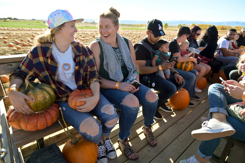 . Kelli Culver, left, and Kaitlin Krattenmaker, both of Arvada, picked four pumpkins from the pumpkin patch at Anderson Farms, 6728 County Road 3 1/4, Monday afternoon. Anderson Farms grows 75 varieties of pumpkins with about 300,000 available to be picked. To view more photos visit timescall.com. Lewis Geyer/Staff Photographer Oct. 16, 2017