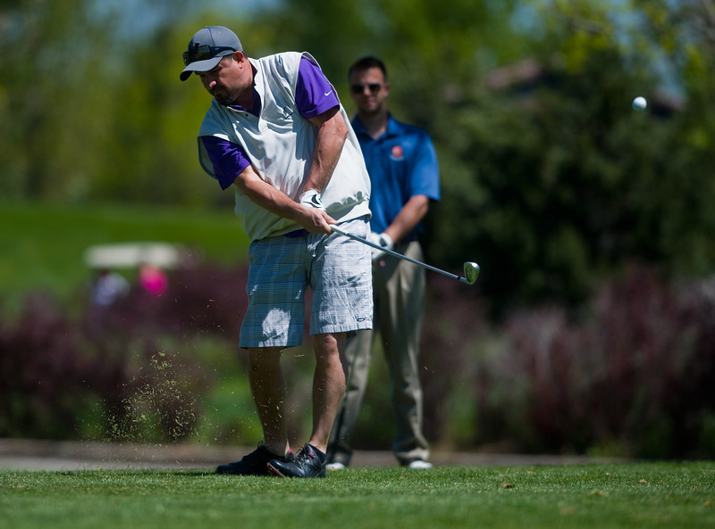 "Robert Lucero tees off at hole 16 during the annual CASA Classic Golf Tournament at Greg Mastriona Courses at  Hyland Hills in Westminister on Thursday. Proceeds raised will go towards CASA's mission of fighting against child abuse and neglect.<br /> More photos:  <a href=""http://www.dailycamera.com"">http://www.dailycamera.com</a><br /> Autumn Parry/Staff Photographer<br /> May 12, 2016"