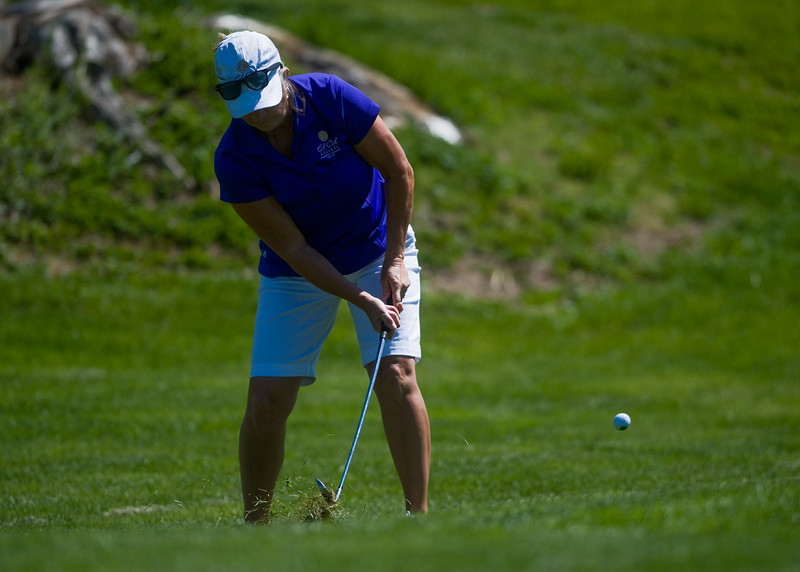 "Linda Morgan chips to the green during the annual CASA Classic Golf Tournament at Greg Mastriona Courses at  Hyland Hills in Westminister on Thursday. Proceeds raised will go towards CASA's mission of fighting against child abuse and neglect.<br /> More photos:  <a href=""http://www.dailycamera.com"">http://www.dailycamera.com</a><br /> Autumn Parry/Staff Photographer<br /> May 12, 2016"