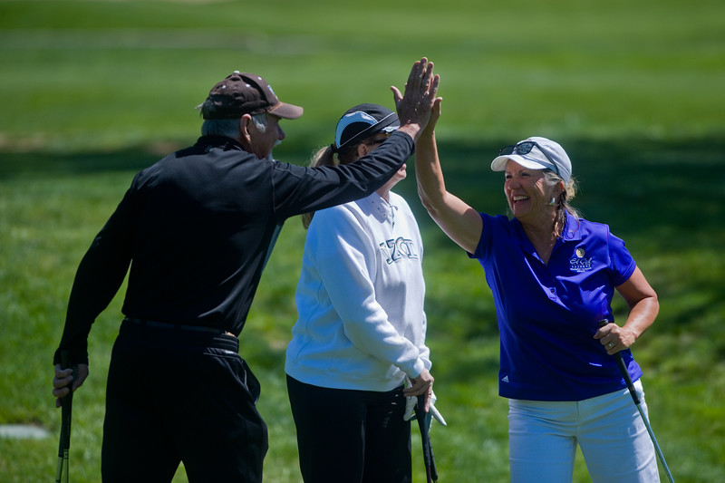 "Bill Alsdorf high fives Linda Morgan during the annual CASA Classic Golf Tournament at Greg Mastriona Courses at  Hyland Hills in Westminister on Thursday. Proceeds raised will go towards CASA's mission of fighting against child abuse and neglect.<br /> More photos:  <a href=""http://www.dailycamera.com"">http://www.dailycamera.com</a><br /> Autumn Parry/Staff Photographer<br /> May 12, 2016"