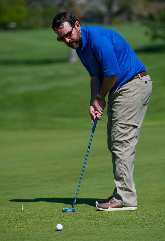 "Chip Parrish putts on the green during the annual CASA Classic Golf Tournament at Greg Mastriona Courses at  Hyland Hills in Westminister on Thursday. Proceeds raised will go towards CASA's mission of fighting against child abuse and neglect.<br /> More photos:  <a href=""http://www.dailycamera.com"">http://www.dailycamera.com</a><br /> Autumn Parry/Staff Photographer<br /> May 12, 2016"