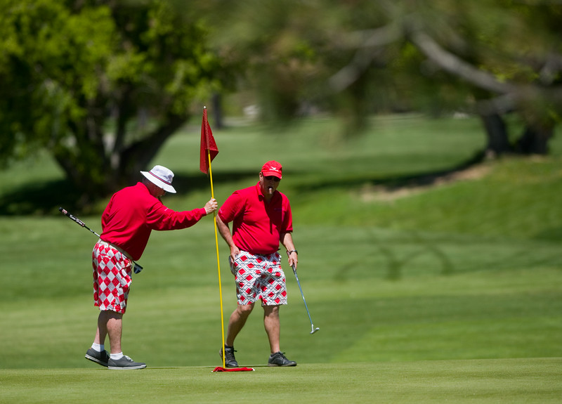 "Paul Siska and Brad Harvey, with Community Reach Center, finish up on the green during the annual CASA Classic Golf Tournament at Greg Mastriona Courses at  Hyland Hills in Westminister on Thursday. Proceeds raised will go towards CASA's mission of fighting against child abuse and neglect.<br /> More photos:  <a href=""http://www.dailycamera.com"">http://www.dailycamera.com</a><br /> Autumn Parry/Staff Photographer<br /> May 12, 2016"