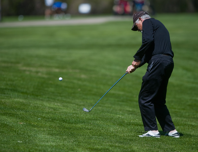 "Bill Alsdorf chips to the green during the annual CASA Classic Golf Tournament at Greg Mastriona Courses at  Hyland Hills in Westminister on Thursday. Proceeds raised will go towards CASA's mission of fighting against child abuse and neglect.<br /> More photos:  <a href=""http://www.dailycamera.com"">http://www.dailycamera.com</a><br /> Autumn Parry/Staff Photographer<br /> May 12, 2016"