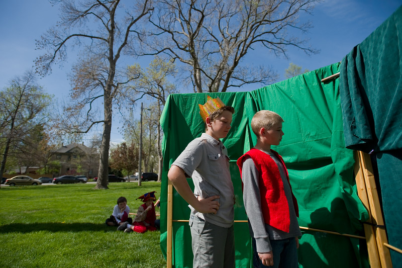 "Griffin Taylor (left) and Quinn Lockwood wait for their cue backstage during the play, ""Hamlet,"" performed by students from Central Elementary during St. Vrain Valley fifth graders' annual Shakespeare Festival at Thompson Park in Longmont on Friday. <br /> More photos:  <a href=""http://www.dailycamera.com"">http://www.dailycamera.com</a><br /> Autumn Parry/Staff Photographer<br /> May 6, 2016"