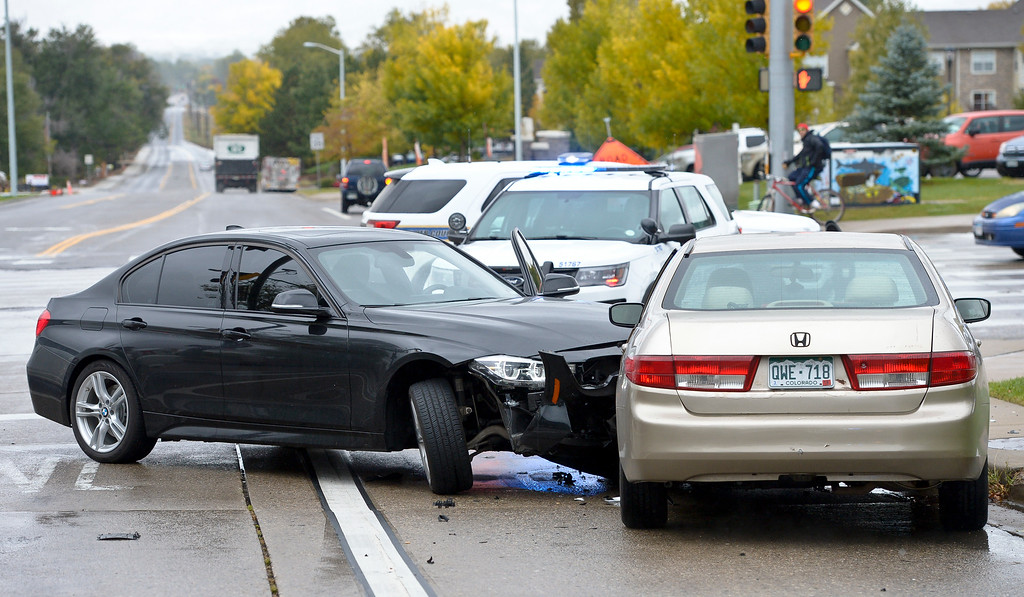 . LONGMONT, CO - OCTOBER 10: The scene of a two-vehicle which crash occurred at Ninth Avenue and Hover Street Oct. 10, 2018. The black BMW was carjacked in Boulder. (Photo by Lewis Geyer/Staff Photographer)