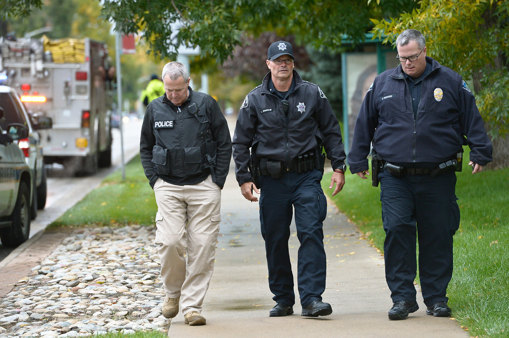 . LONGMONT, CO - OCTOBER 10: Longmont and Boulder County Sheriff\'s officials at Ninth Avenue and Hover Street Oct. 10, 2018 where an armed carjacking suspect fled from the scene of a two-vehicle crash. The carjacking occurred in Boulder. (Photo by Lewis Geyer/Staff Photographer)