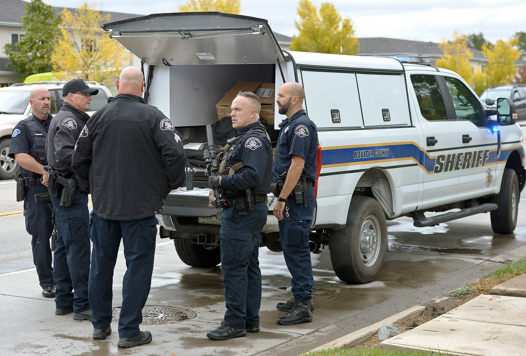 . LONGMONT, CO - OCTOBER 10: Boulder County Sheriff\'s deputies gather at Ninth Avenue and Hover Street after searching for an armed carjacking suspect in the Hover Ridge neighborhood Oct. 10, 2018. The carjacking occurred in Boulder. (Photo by Lewis Geyer/Staff Photographer)