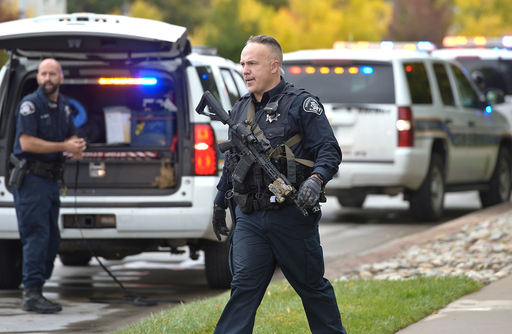 . LONGMONT, CO - OCTOBER 10: A Boulder County Sheriff\'s deputy returns to Ninth Avenue and Hover Street after searching for an armed carjacking suspect in the Hover Ridge neighborhood Oct. 10, 2018. The carjacking occurred in Boulder. (Photo by Lewis Geyer/Staff Photographer)