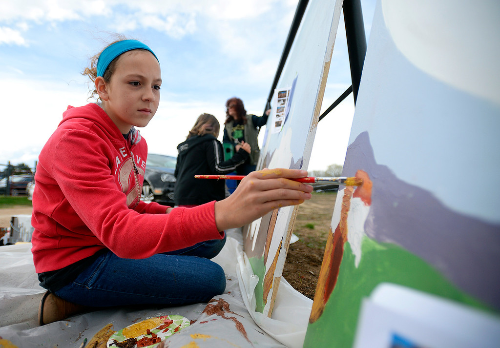 . Abi Attwell, 12, with the Artism program, paints a hen while helping to create a mural for the Luvin Arms Farm Sanctuary in Lafayette on Sunday. Kira Horvath / Staff Photographer / April 10, 2016