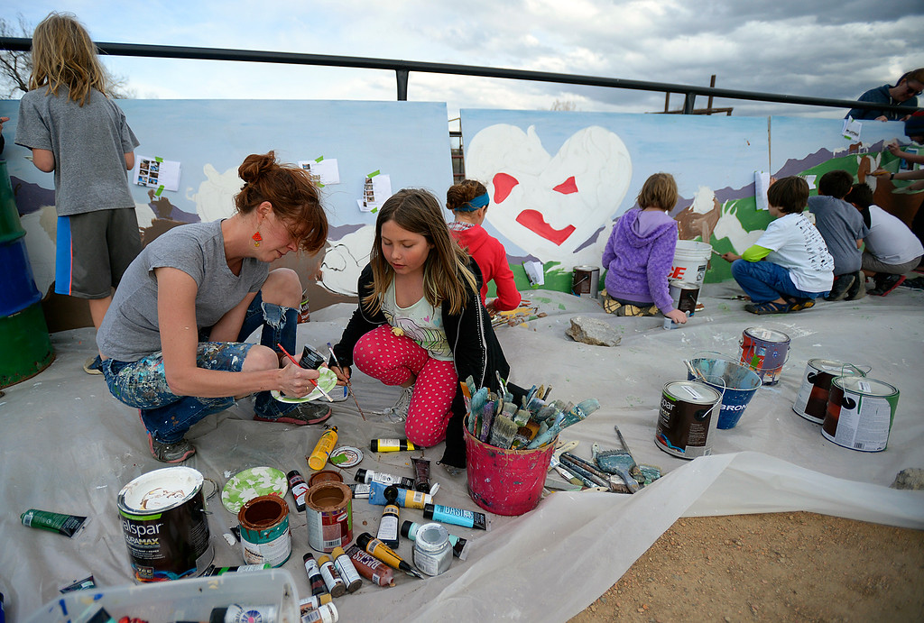 . Muralist Sarah Spencer helps Jessica Robb, 9, pour some paint as they create a mural for the Luvin Arms Farm Sanctuary in Lafayette on Sunday. Kira Horvath / Staff Photographer / April 10, 2016