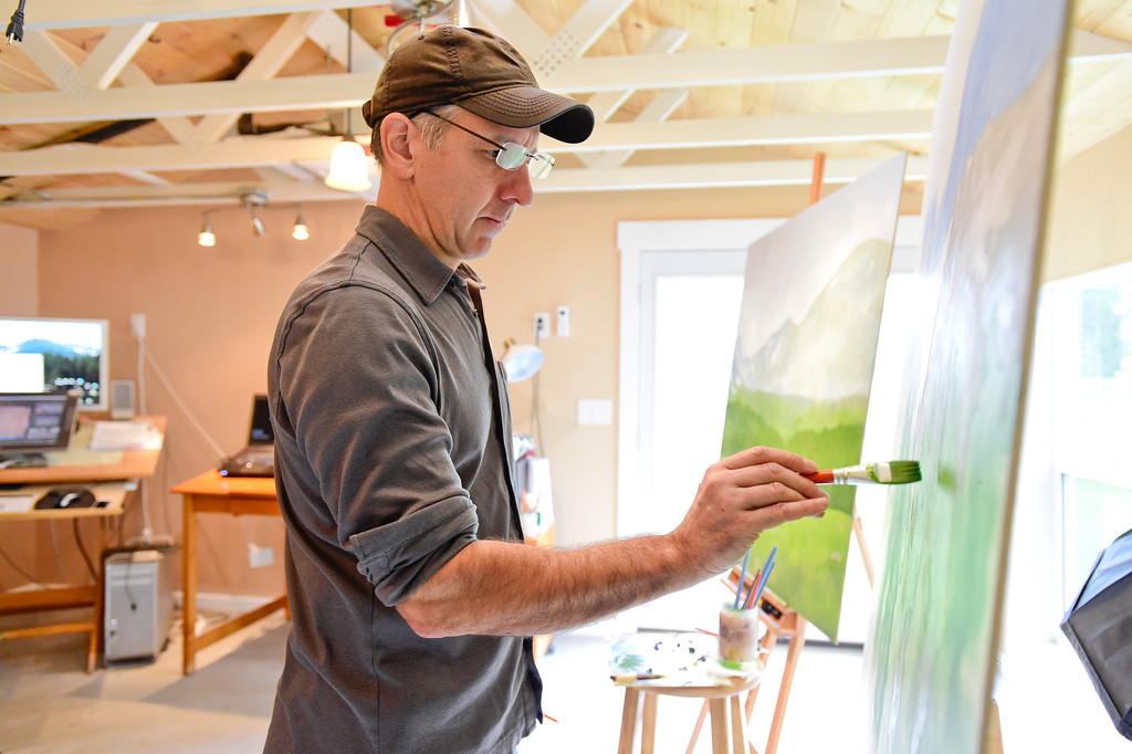 . Artist Daev Finn paints in his studio near Niwot, Colorado on Oct. 3, 2017. (Photo by Matthew Jonas/Times-Call)