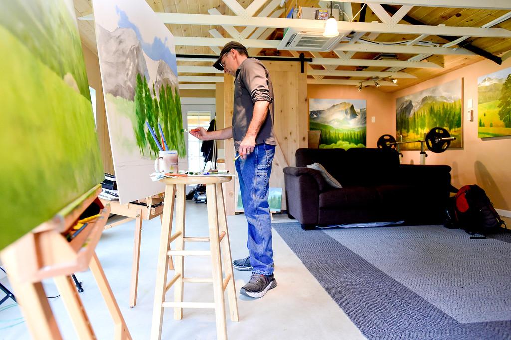 . Artist Daev Finn paints in his studio near Niwot, Colorado on Oct. 3, 2017. (Photo by Matthew Jonas/Times-Call)