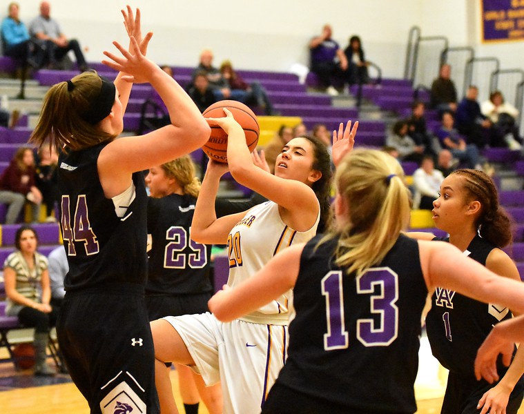 Boulder's Grace Chow challenges the defense during the Panthers' game against Arvada West on Monday, Dec. 17, at Boulder High.