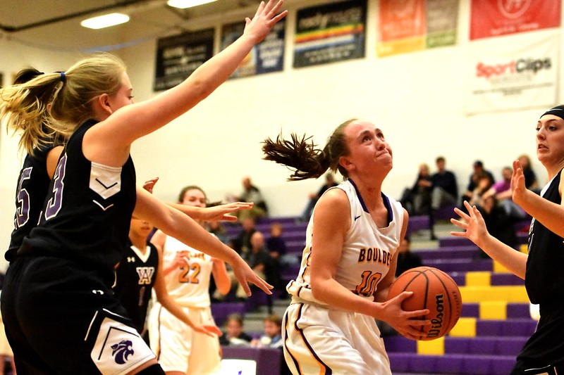 Boulder's Abbie Gillach drives in traffic during the Panthers' game against Arvada West on Monday, Dec. 17, at Boulder High.